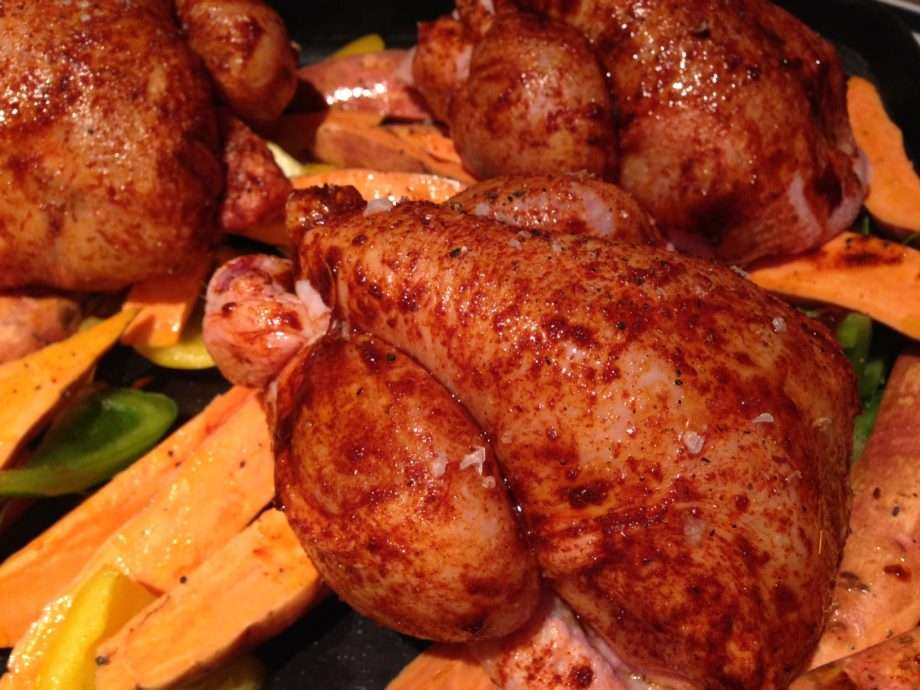 Roast poussins with sweet potato, peppers and chorizo - Caroline Barty