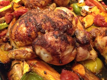 Roast poussins with sweet potato, peppers and chorizo