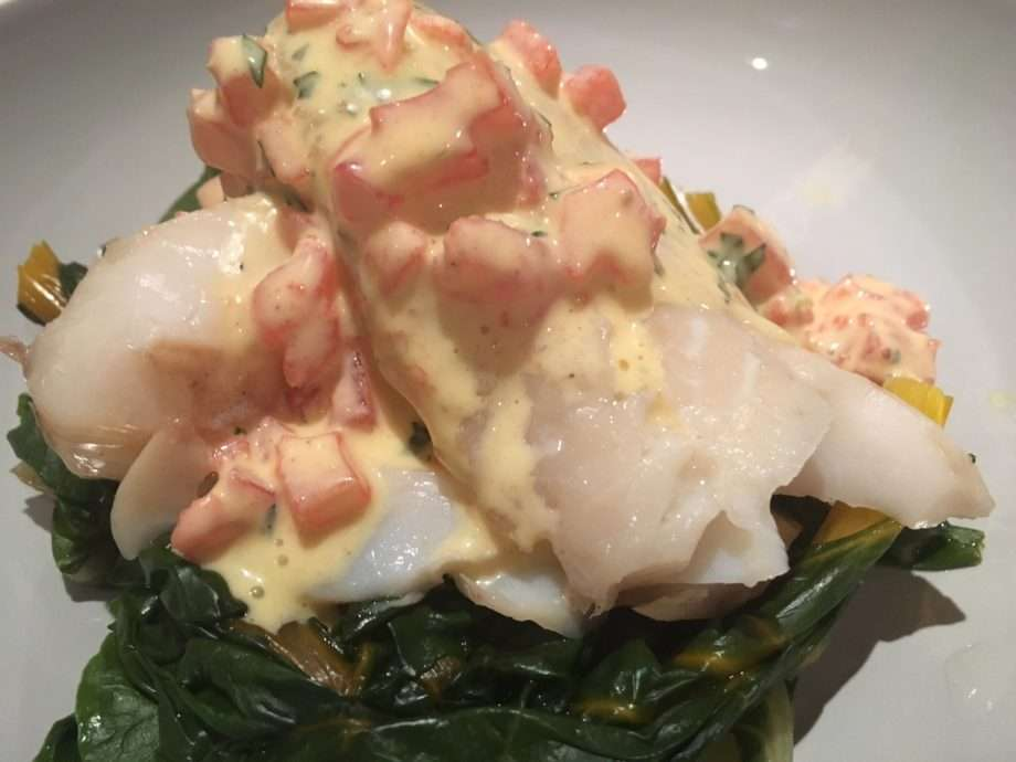 Smoked cod with steamed swiss chard and tomato and tarragon hollandaise sauce