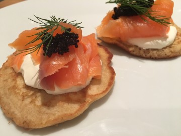 Buckwheat blinis with smoked salmon, sour cream and caviar