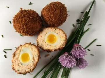 Smoked salmon scotch quail eggs