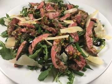 Tagliata with beans, rocket and shaved parmesan, pine nut gremolata