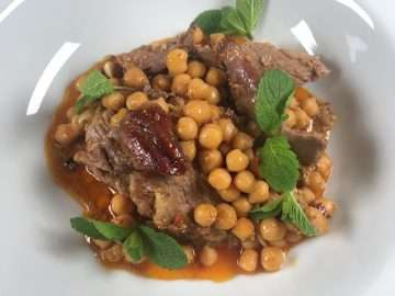 Slow-roasted lamb shoulder with harissa, yogurt and chickpeas