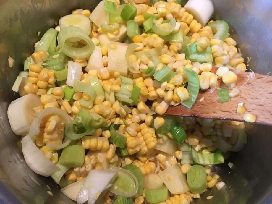 Corn soup with wild garlic cream