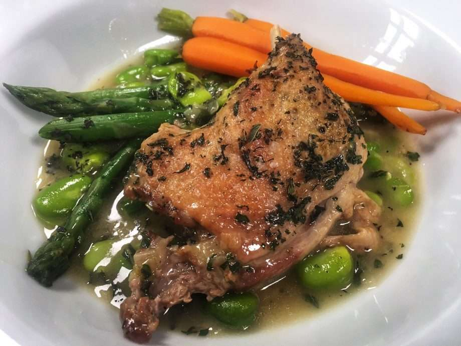Braised duck legs with spring vegetables and mint