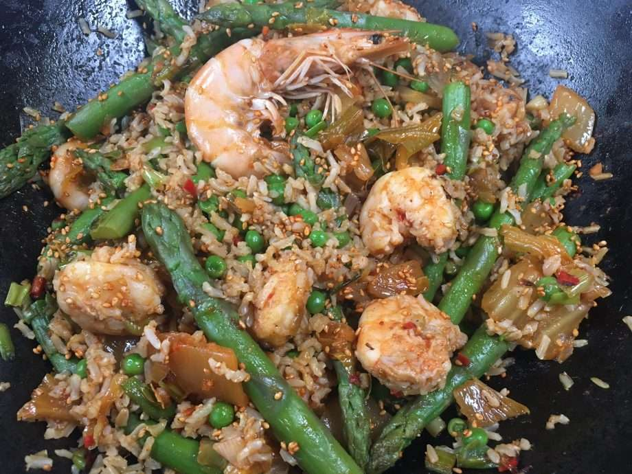 Prawn and kimchi fried rice with asparagus and peas