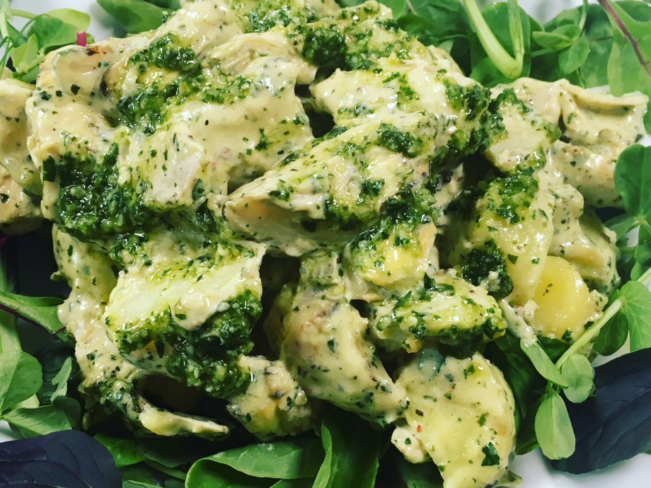 Warm pesto and potato salad with charred artichokes