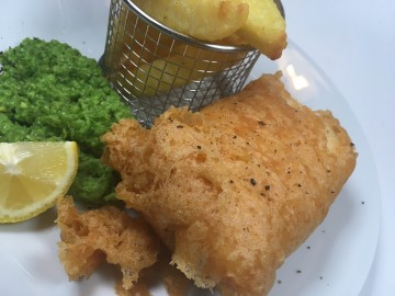 Gluten-free fried fish with minted vinegar peas