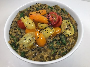 Spiced lentils with spinach and tomatoes