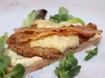 Veal schnitzel with melted cheese and bacon